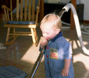 toddler vacuuming