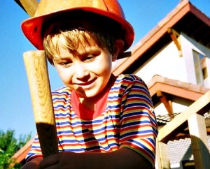 Grow the Can-DO DIY Mindset. Young Dale Stephens in construction hat helping his dad build a playhouse. www.LisaNalbone.com