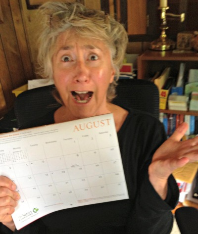 Lisa Nalbone looking scared holding August calendar